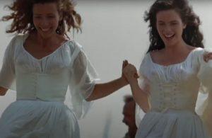 Image of two women running hand in hand