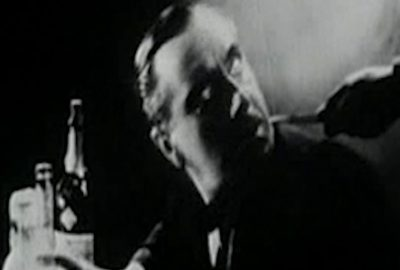 Picture of a man with a knife to his neck from the 1933 movie the Ghoul